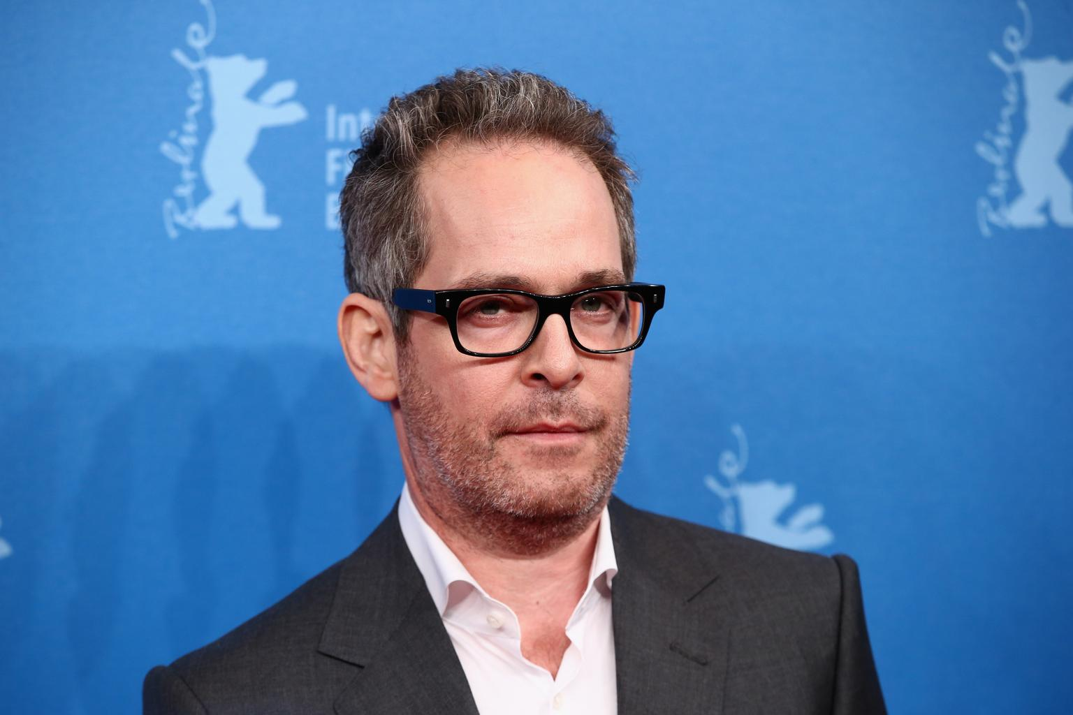 who is tom hollander partner