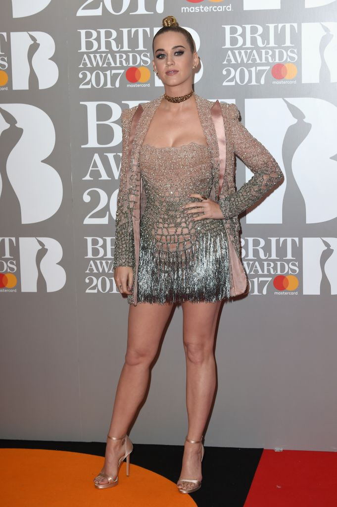f44d8224 The headliner performer, Katy Perry chose a silver and blush pink sparkling  mini dress and jacket combo for her red carpet appearance.