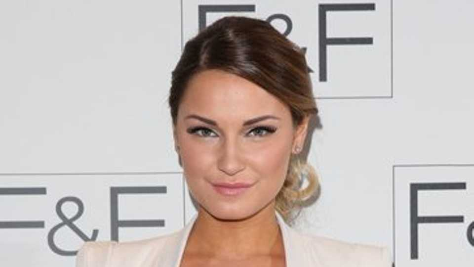 959f9238a8a84 The Only Way Is Essex's Sam Faiers showed she was on the road to recovery  as she modelled a stylish crop top teamed with white trouser suit on the  red ...