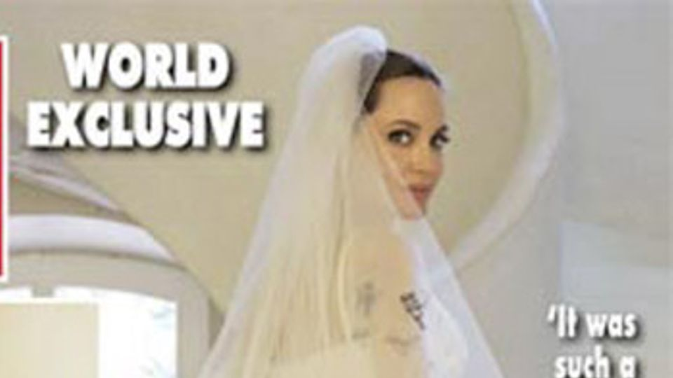 Omg The First Pictures Of Angelina Jolie S Wedding Dress Are Here And Her Kids Drawings Are All Over It Grazia