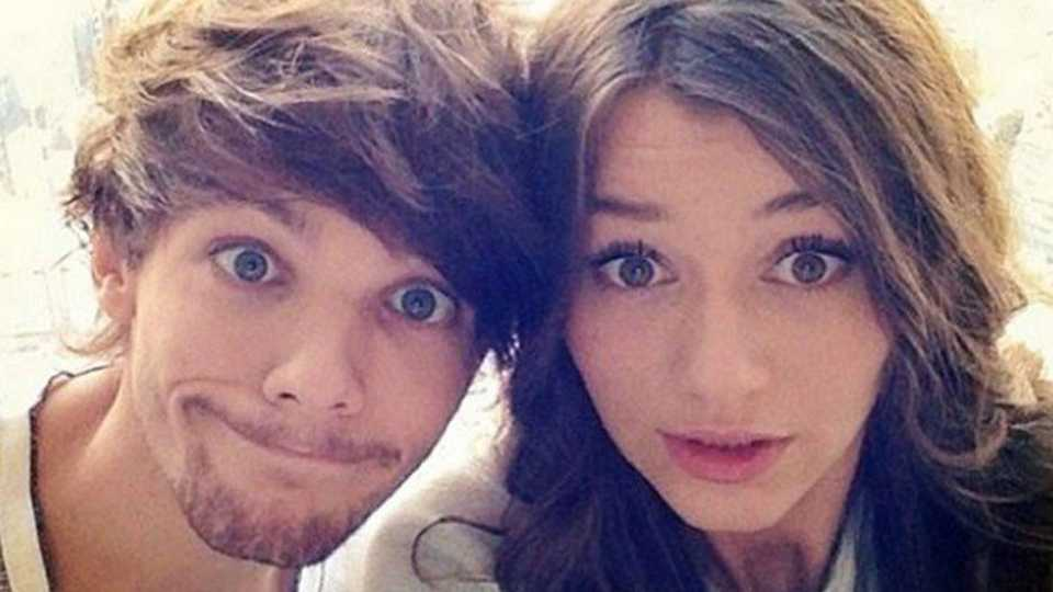16478803b786 One Direction singer Louis Tomlinson poses with girlfriend Eleanor Calder  for selfie