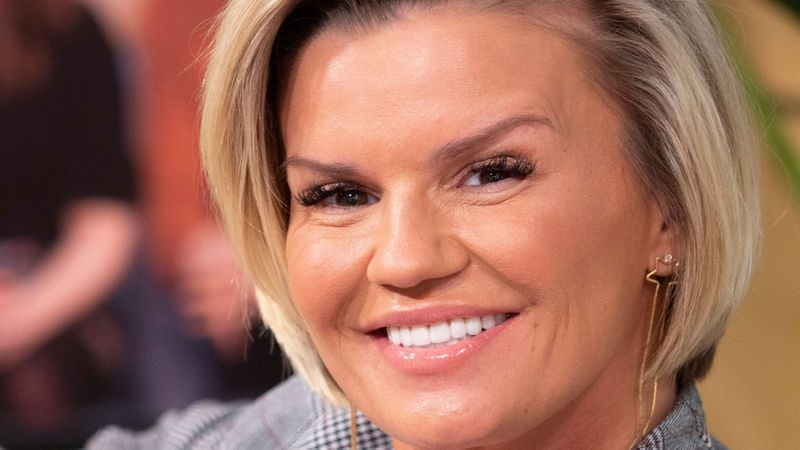 Kerry Katona debuts extreme new hair do and hunky new man