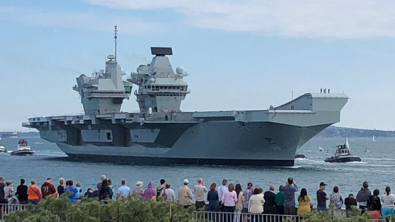 Britain's biggest warship returns to Portsmouth after captain removed from post