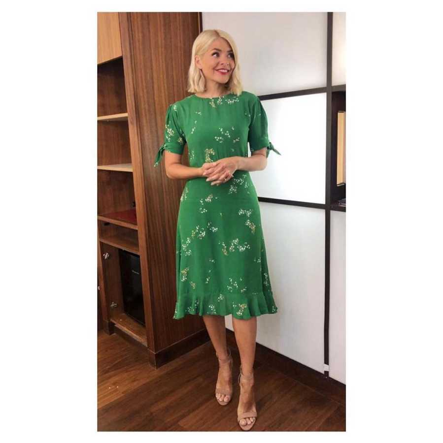 6ca4b98dff4d WEDNESDAY 3 July. It's the middle of the week and Holly is rocking a green  floral printed dress and nude sandal heels.