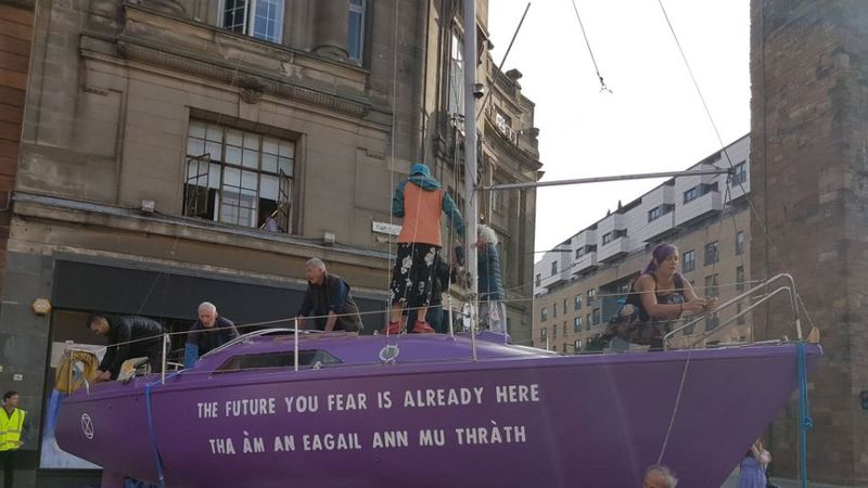 Extinction Rebellion block busy Glasgow road with 25ft purple boat