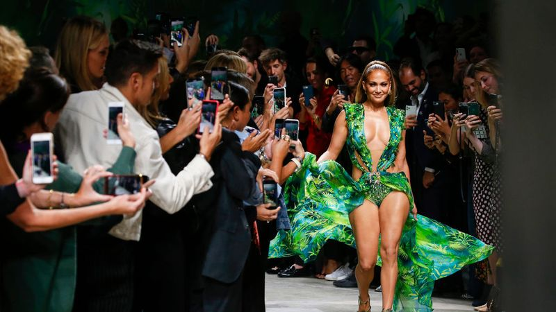 JLo Walks Versace In A 2019 Update Of The Dress Which Inspired Google Image Search. Read More On Grazia.