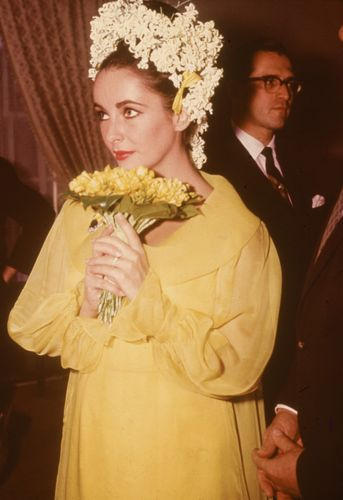 For her first marriage to Richard Burton, Elizabeth Taylor wore a yellow dress by Cleopatra's costume designer Irene Sharaff