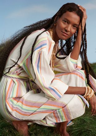 Liya Kebede wearing a striped dress from her collection with H&M