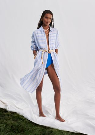 Liya Kebede wearing a striped shirt dress and jewellery from her collection with H&M